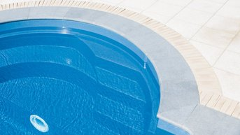 High-gloss pool surface with shallow water area
